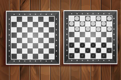 Vector set of chess boards on wooden background Stock Photography