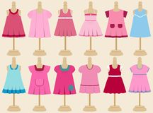 Vector set of children's dresses on mannequins. Royalty Free Stock Images