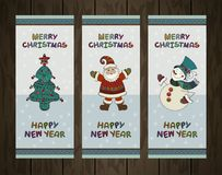 Vector set of christmas backgrounds. Christmas. Banners with Christmas Tree, Santa Claus and Snowman on wood texture. Merry Christmas and Happy New Year Labels Stock Image