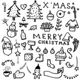 Vector set of Christmas drawn doodles in black line on white background Royalty Free Stock Photos