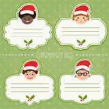 Vector set of christmas gift tags for presents with children smiles Stock Photography
