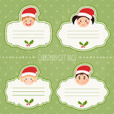 Vector set of christmas gift tags for presents with children smiles Stock Images