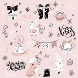 Vector set of christmas hand drawn decorative elements and characters - gift, sock, fir-tree and hand lettering.  Royalty Free Stock Image