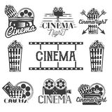 Vector set of cinema labels and logos. Isolated illustration in vintage style. Monochrome badges, emblems, design. Vector set of cinema labels and logos Stock Photo