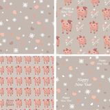 Vector set collection. Seamless patterns with pigs, snowflakes and hearts on a beige background. Vector textile fabric print. New year 2019. Vector royalty free illustration