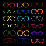 Vector set of colored glasses. Retro, geek. Vector set of different colored glasses on black background. Retro, wayfarer, aviator, geek, hipster frames. Man and Stock Photography