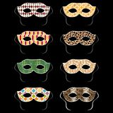 Vector set of colorful carnival masquerade ball masks. Isolated on black background royalty free illustration