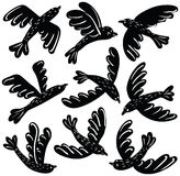 Vector set of cute black birds stickers. Vector collection of cute black birds stickers. Cartoon silhouette animal icon set Royalty Free Stock Images