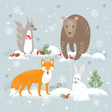 Vector set of cute forest animals: fox, bear, rabbit and squirrel on winter background. royalty free illustration