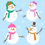 Cute snowmen with hats and scarves Stock Photos