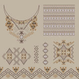 Vector set of decorative elements for design and fashion in ethnic tribal style. Neckline, borders, patterns and seamless texture Royalty Free Stock Photography