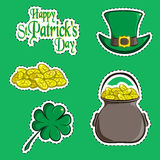 Vector set of design element and scrapbook object of St. Patrick`s Day symbols. Greeting inscription, green hat, a handful of coin Stock Photos