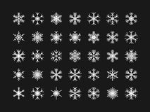 Vector set of different snowflakes on black background Royalty Free Stock Photo