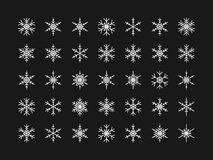 Vector set of different snowflakes on black background Stock Photography