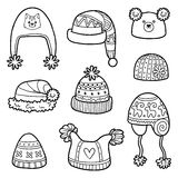Vector set of different winter hats with animals and geometric pattern Stock Image