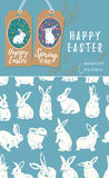 Vector set of Easter tags and Rabbit easter seamless pattern. Vector set of Easter labels and blue seamless pattern with bunnies Royalty Free Stock Images