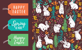 Vector set of Easter tags and seamless pattern. Vector Set of Easter holiday labels and seamless floral pattern with white rabbits Stock Image