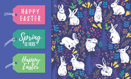 Vector set of Easter tags and seamless pattern. Vector Set of Easter holiday labels and seamless floral pattern with white rabbits Stock Photography