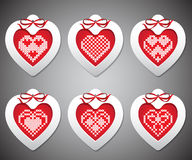 Vector set of embroidered with New Year hearts. Vector set of embroidered New Year hearts in gray background Royalty Free Illustration