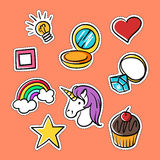 Vector set of fashionable patches: star, heart, ring, rainbow. Royalty Free Stock Photos
