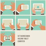 Vector set of flat hand icons holding various hi-. Tech computer and communication devices Stock Images