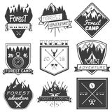 Vector set of forest camp labels in vintage style. Design elements, icons, logo, emblems and badges isolated on white Royalty Free Stock Photography