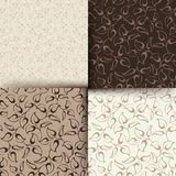Set of brown and beige floral patterns. Vector illustration. Vector set of four brown and beige floral patterns Royalty Free Stock Photo