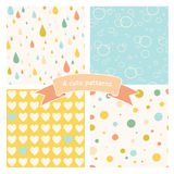 Vector set of four seamless patterns. Simple colorful textures with drops, hearts, circles and bubbles Stock Photo