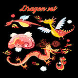 Vector set of funny lovely dragons. On a dark background Royalty Free Stock Photos