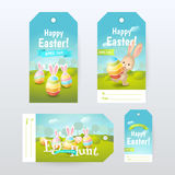 "Vector set of Gift Tags with title ""Happy Easter"" and ""Egg Hunt"" with colored eggs and cute bunny. Labels with spring scene for holiday design Stock Images"