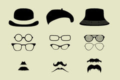 Vector set of glasses, mustache and hats Stock Photography