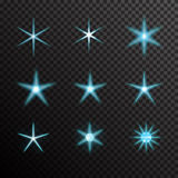 Vector set of glowing light bursts on black Royalty Free Stock Images