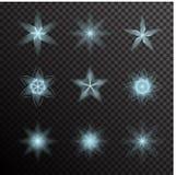 Vector set of glowing light bursts on black Stock Image