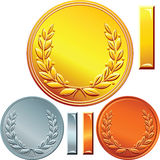 Vector Set of gold, silver and bronze coins. Vector Gold, silver and bronze coins or medals for winning the competition with the image of a laurel wreath Royalty Free Stock Photography