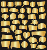 Vector set of golden arrow shapes isolated on black Royalty Free Stock Photos