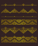 Vector set of golden vignettes and borders for design template. Stock Image