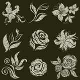 Vector set of grunge leafs and flowers Stock Image
