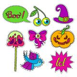 Cartoon badge,sticker. Vector set of Halloween Cartoon badge,sticker.Hand drawn symbols with skull,cherry,eye,witch hat, apple on a stick,bow,pumpkin,swallow Royalty Free Stock Images