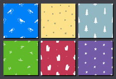 Vector set of hand drawn colorful seamless Christmas patterns. Use as background, wallpaper, decor, paper wrapping. Doodle birds, trees, stars, snowflakes vector illustration