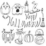 Vector set of hand drawn doodles and lettering. Happy Halloween. Happy Halloween - vector set of hand drawn doodles and lettering. black line art on white Stock Photo