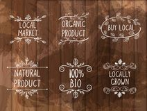 Vector Set of Hand Drawn Floral Frames with Handwritten Words on Wooden Background, Farmers Market, Local Products. stock illustration
