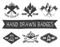 Vector set of hand drawn forest camp labels in vintage style. Design elements, icons, logo, emblems and badges isolated Royalty Free Stock Photo
