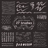 Vector set of 27 hand-drawn grunge brushes Royalty Free Stock Photos
