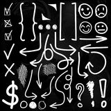VECTOR set of hand drawn icons. Check, exclamation marks, circles, parentheses, arrows. Chalk drawings set. On black background Royalty Free Stock Images