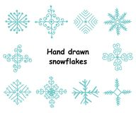 Vector set of hand drawn snowflakes. Christmas and New Year elements for your design Royalty Free Stock Photo