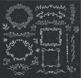 Vector set of hand drawn vintage dividers, frames, flowers, ribbons. Black and white. Stock Image