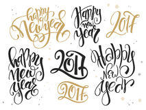 Vector set of hand lettering new year quotes - happy new year and numbers, written in various styles.  Royalty Free Stock Images