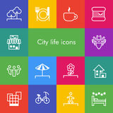 Vector set of 14 icons showing city life in outline style Stock Photos