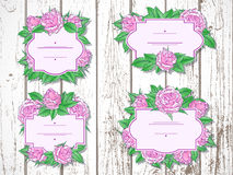 Vector set of labels with hand drawn roses and leaves. Vector set of labels with hand drawn roses and leaves on wooden background. In lilac and green colors Stock Image
