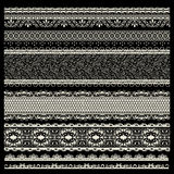 Vector set of lace trims. On black background Royalty Free Stock Photo